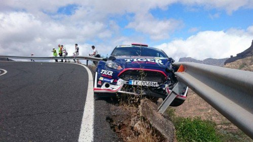 Guardrail catches rally Ford Fiesta from falling off a cliff