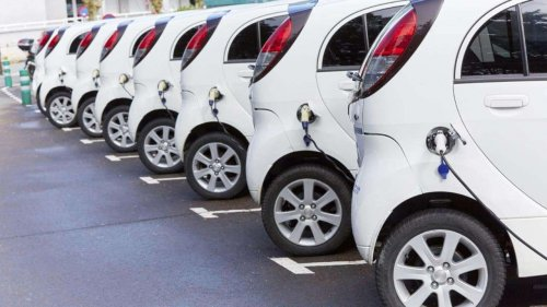 fleet-of-electric-vehicles-plugged-in-xlarge