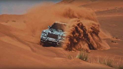 rolls royce cullinan in the sand