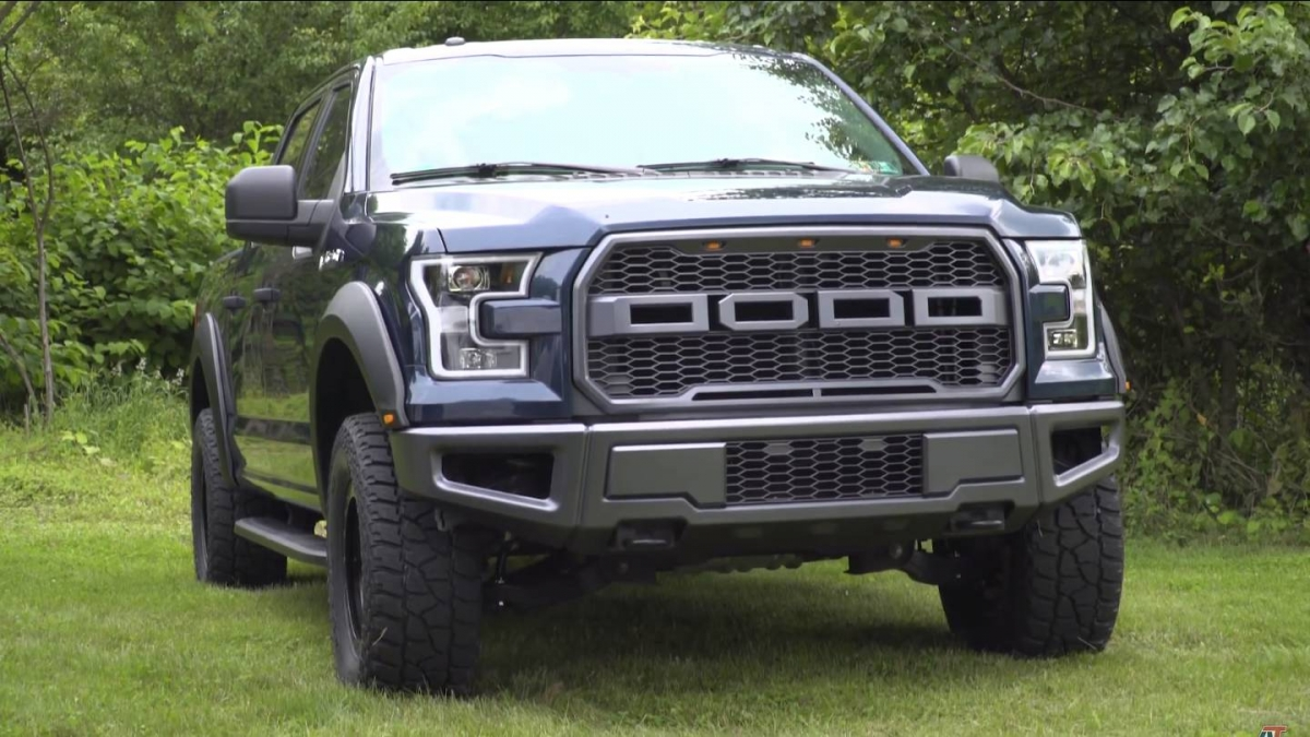 Americantrucks built a ford f 150 raptor clone using aftermarket parts
